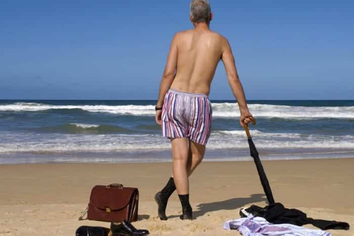 man relaxing on the beach undressed