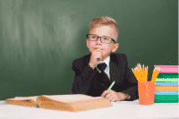 Pensive child student wearing a suit